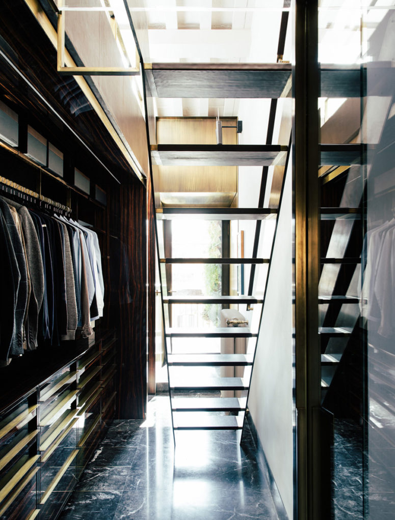 The closet is hidden downstairs, it's elegant, light-filled and with bold brass accents