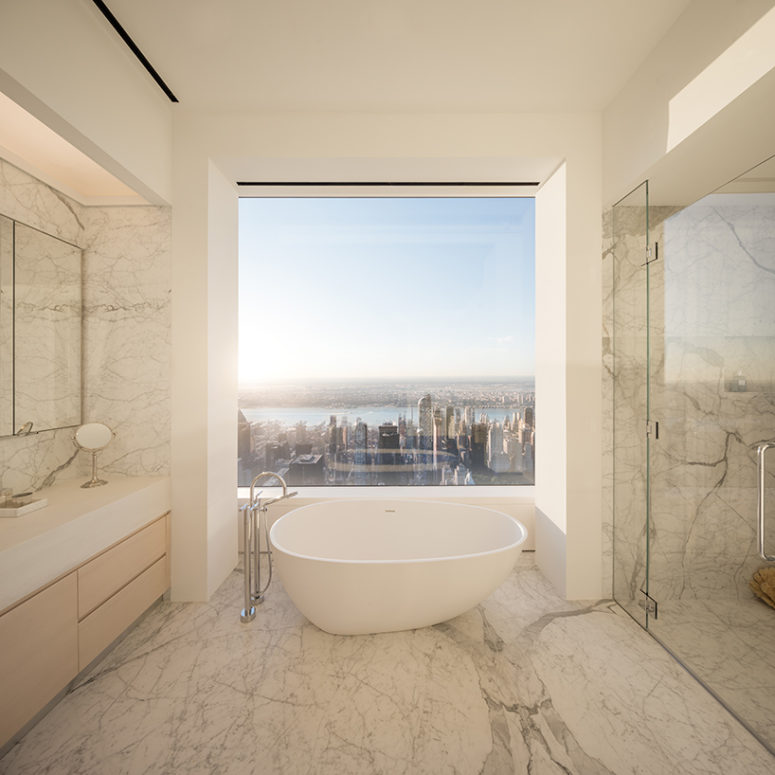 The master bathroom features an amazing view but seems simple but it's not because of adorable marble used for decor