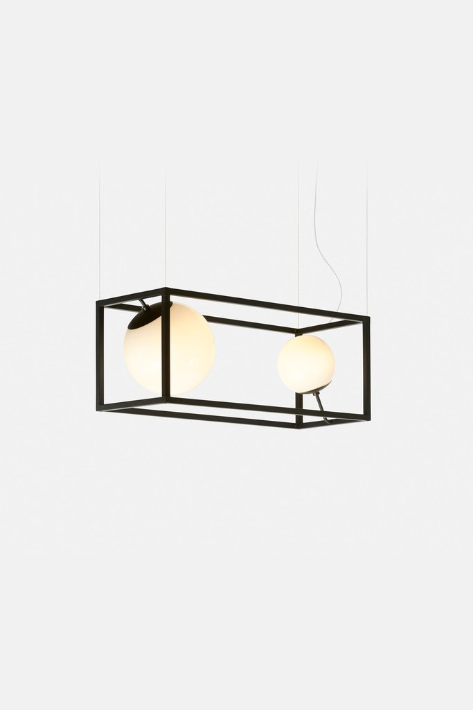 Witt 2 is a lamp that is longer and there are two spheres, it's a fresh take on a traditional chandelier