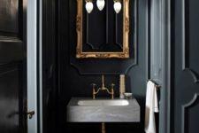 04 dark grey bathroom with a concrete sink and a refined framed mirror