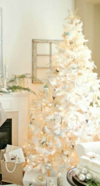 elegant christmas tree with silver ornaments and a gold topper - Elegant White Christmas Decorations