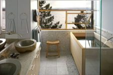 04 light Japanese bathroom with stone sinks, a wooden bathtub, light tiles and stone