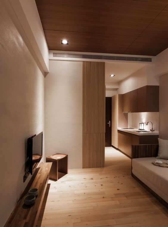 modern small living room with an extensive use of light wood and cream walls