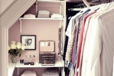 04 tiny walk-in closet with a leading rack on the right and open shelving in the center