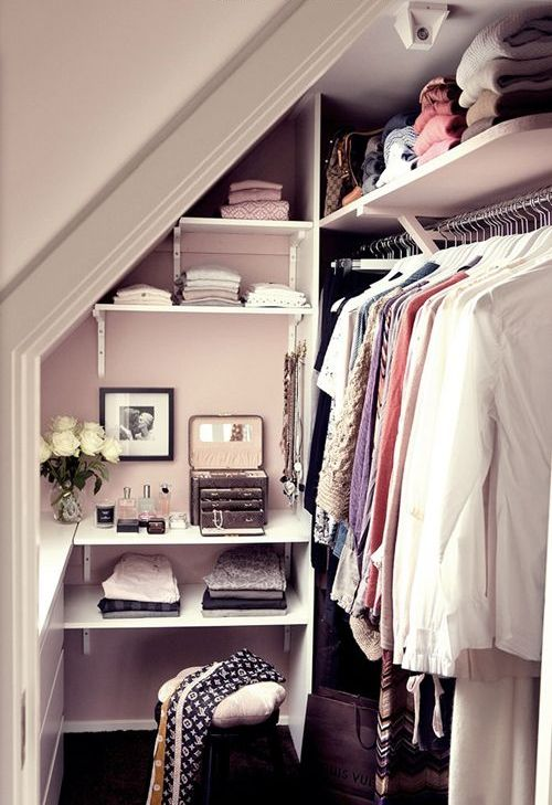 Tiny Walk In Closet With A Leading Rack On The Right And Open Shelving