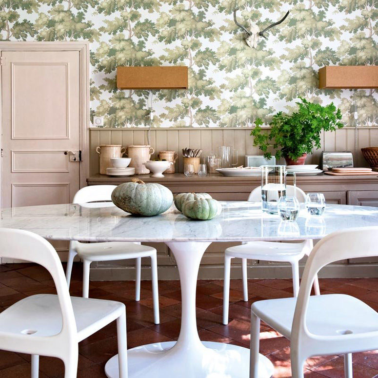 The dining room blends a vintage table, IKEA chairs and traditional wood furniture