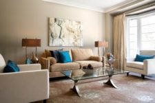 05 eclectic lviing room in calm brown shades with a couple of bold blue pillows