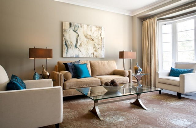 Superior Eclectic Lviing Room In Calm Brown Shades With A Couple Of Bold Blue Pillows