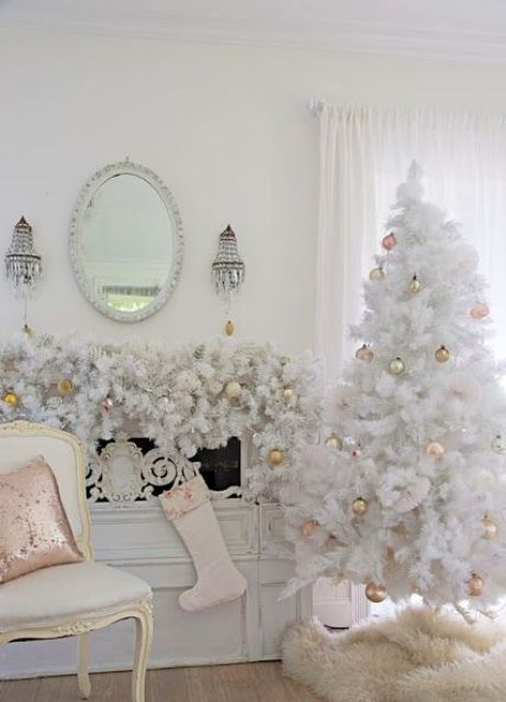 elegant vintage tree with gold ornaments and a garland over the mantel that echoes with it - White Christmas Tree With Gold Decorations