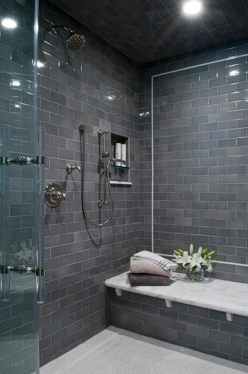 modern shower and bathtub fully clad with grey subway tiles
