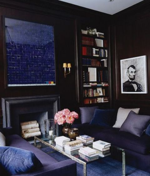 navy living room with a faux fireplace and a navy mirror over it