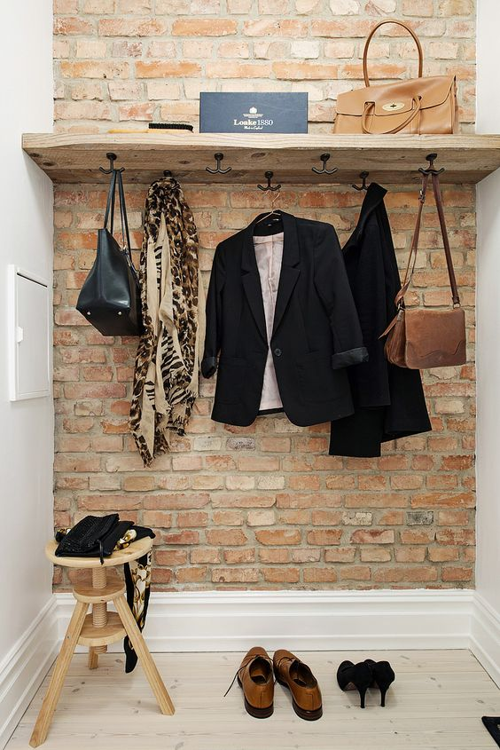 simple small entryway is given style with a brick veneer wall that can be installed without much fuss