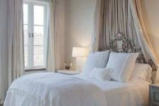 05 tihs vintage bedroom has just a candle-styled chandelier and a couple of lamps by the bed
