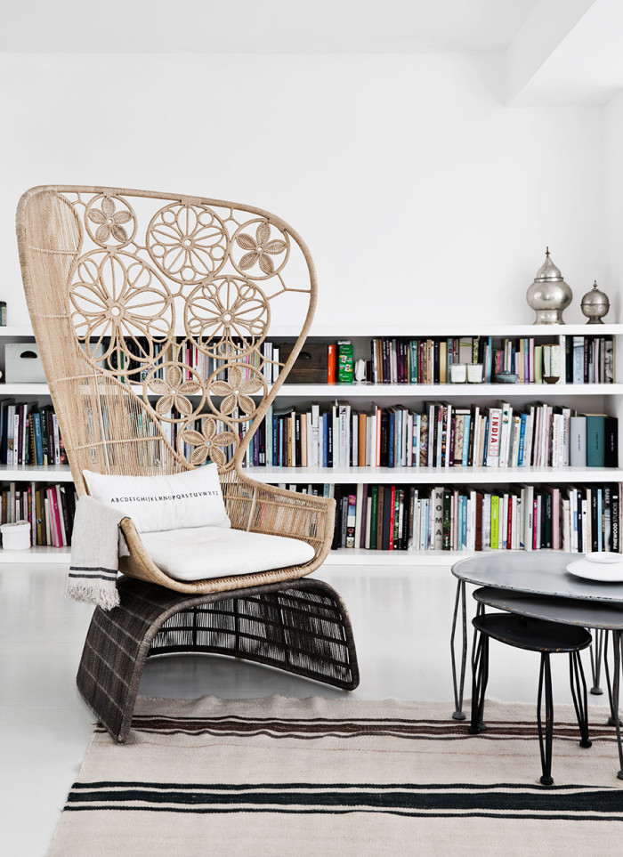 A woven boho chair stand out from this white glazing