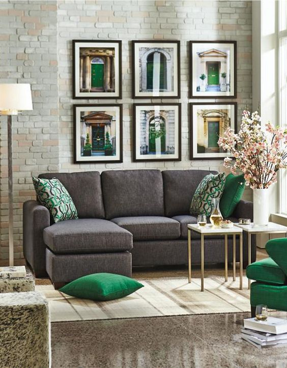 charcoal grey sofa, grey stone floors and emerald and gold details for a chic and sophisticated look