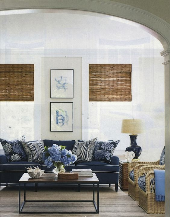 elegant beachy cottage living room design with soft sand walls paint color,  bamboo roman shades