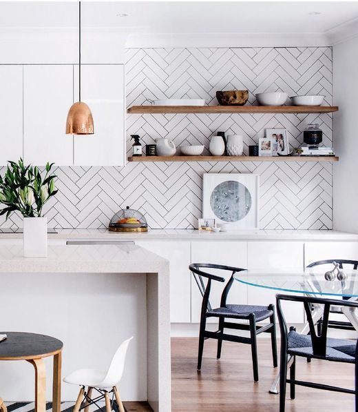 herringbone clad wall with subway tiles for functionality in the kitchen