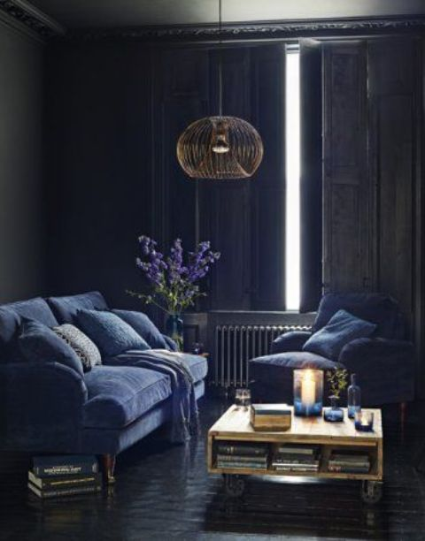 vintage sitting room with indigo furniture and traditional shutters