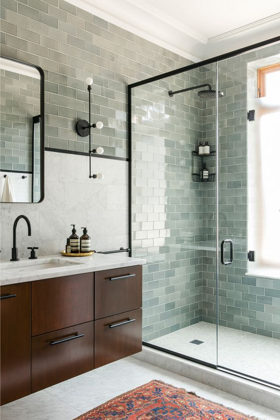 aqua-toned subway tiles for cladding a shower