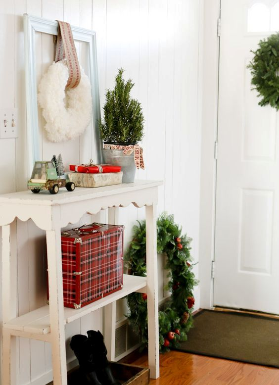 evergreen wreaths and gift boxes will create a festive mood