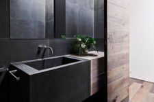 07 minimal bathroom space in black that is softened with reclaimed wood