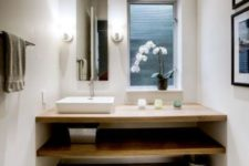 07 minimalist Japanese bathroom with white concrete walls and light woods
