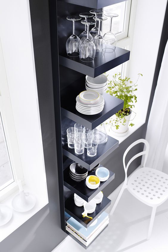 put your dinnerware and drinkware on display with black Lack shelves