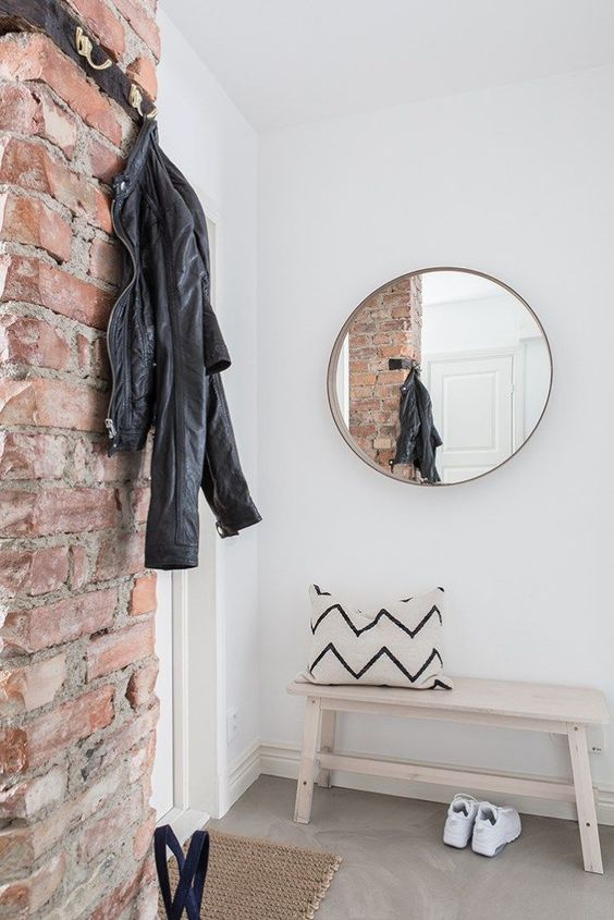 be on trend with a brick wall that will give a textural look and a bit of style to your entryway