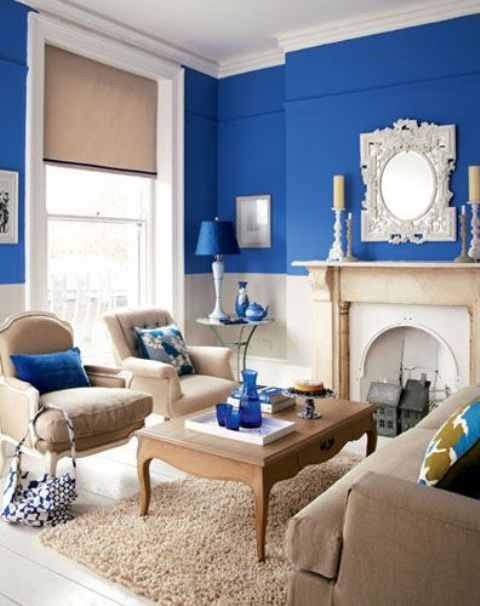 Beautiful Beige Room With Splashes Of Bright Blue And A Bright Blue Acent  Wall