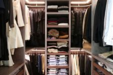 08 open shelves and rackks all over the closet to accomodate as much as possible