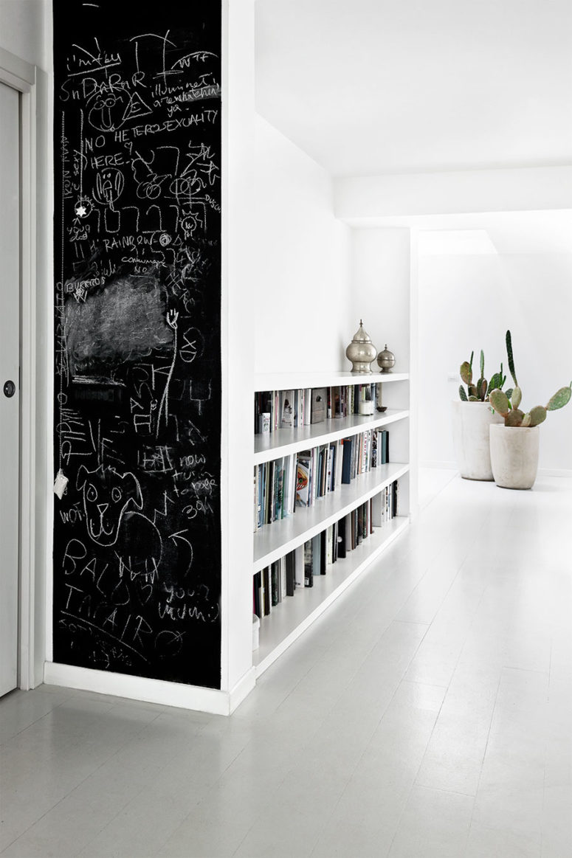 A chalkboard bookshelf side inspires kids' creativity