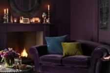 09 deep and moody aubergine purple of this living room draws one in