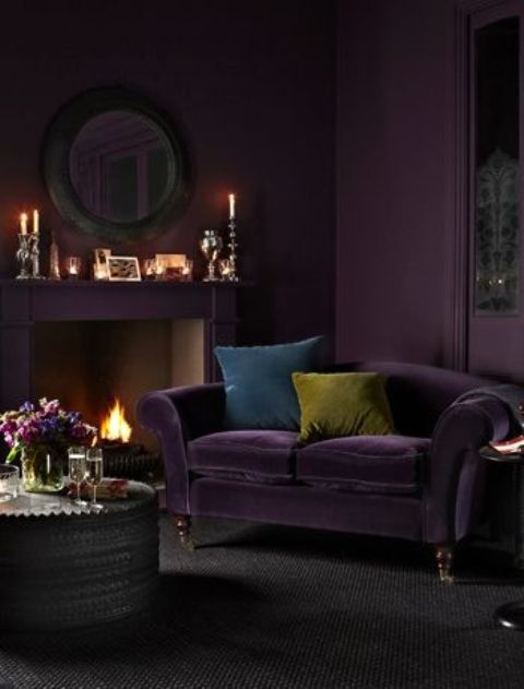 deep and moody aubergine purple of this living room draws one in