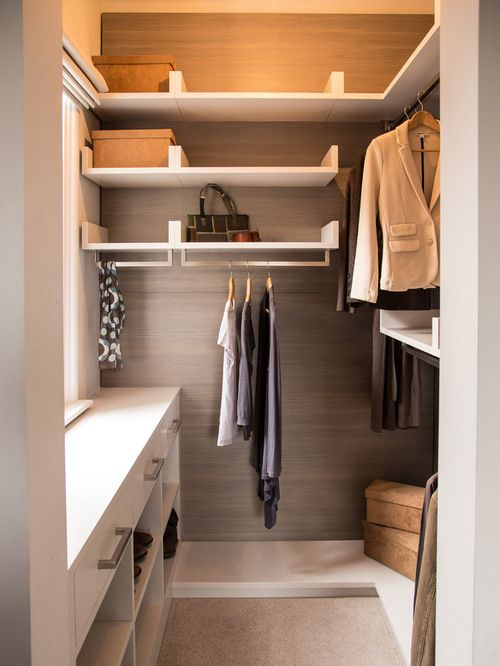 drawers and open shelves under the window, open shelving and rack on the other walls