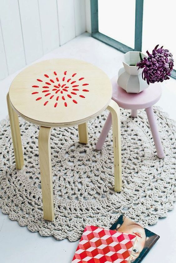 embroidered stool with red yarn