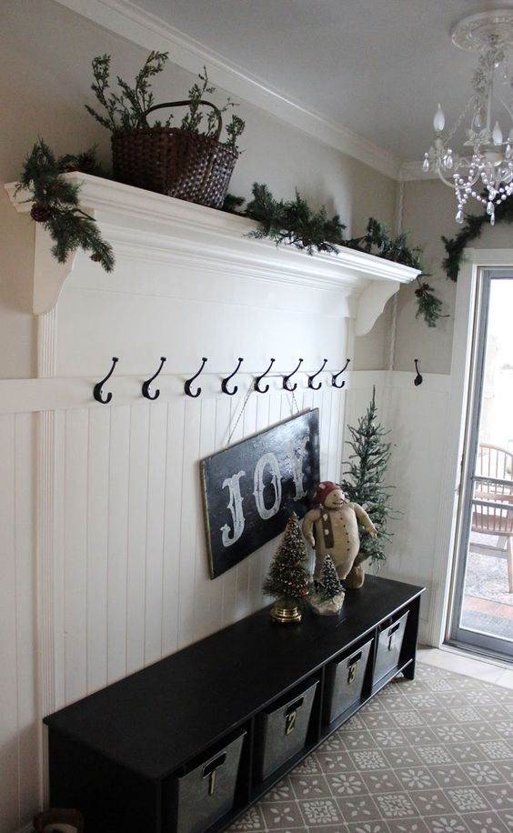 fir branch garland and a chalkboard sign, a stuffed snowman