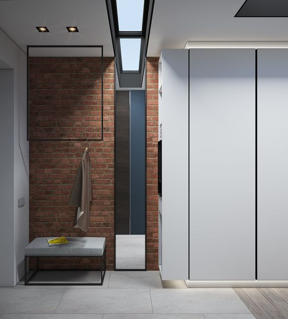 minimalist entryway defined with a red brick panels on the wall