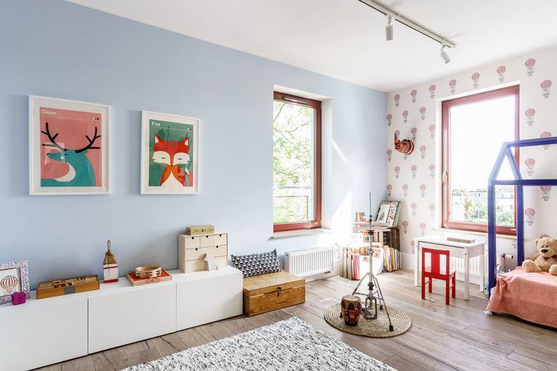 The kid's room is done in pastels and highlighted with bold touches