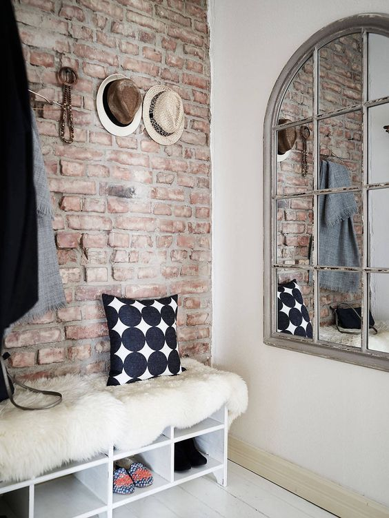 a vintage-inspired entryway decrated with brick plywood panels to give it a style
