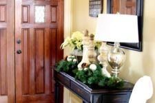 10 evergreen wreaths and garlands, some silver ornaments