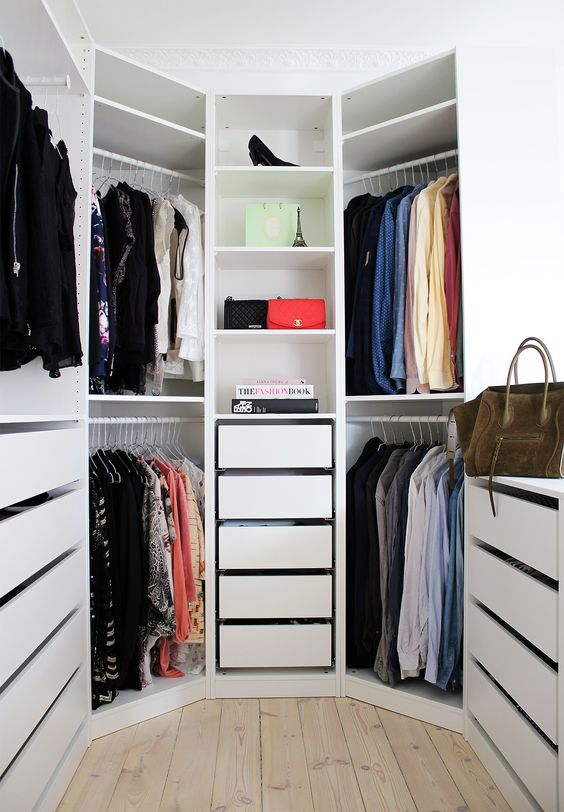 hexagon shaped closet with drawers and open shelving a window brings in much light - Small Walk In Closet Design Ideas
