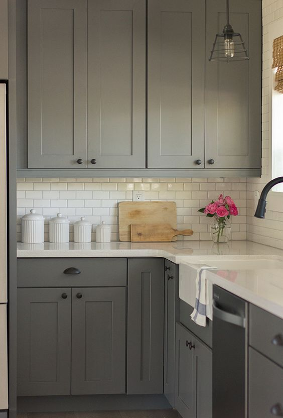 mid century modern kitchen with an ivory subway tile backsplash