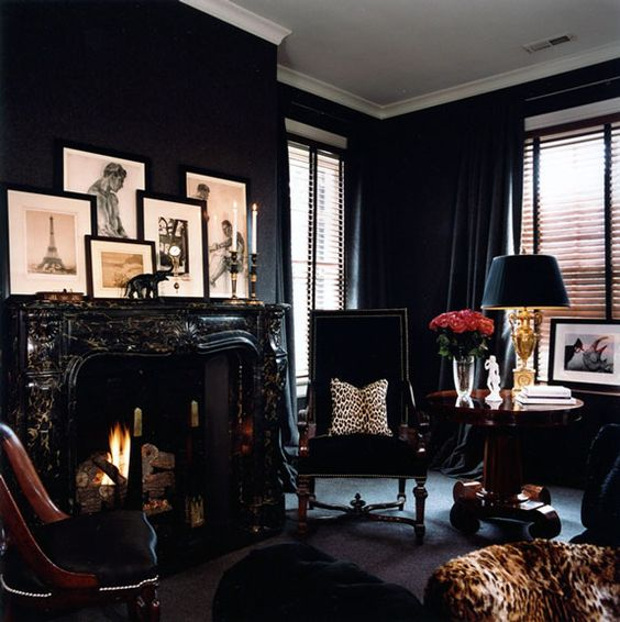 monochromatic black living room with leopard print touches