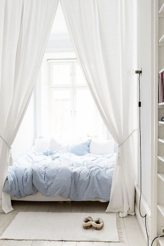 thin striped soft blue bedding for a relaxing bedroom