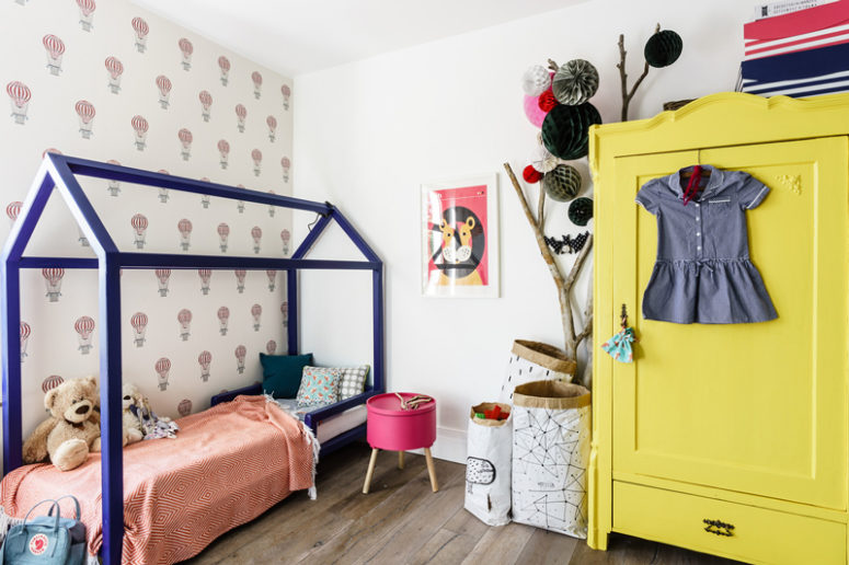 A blue house bed and a sunny yellow wardrobe are amazing
