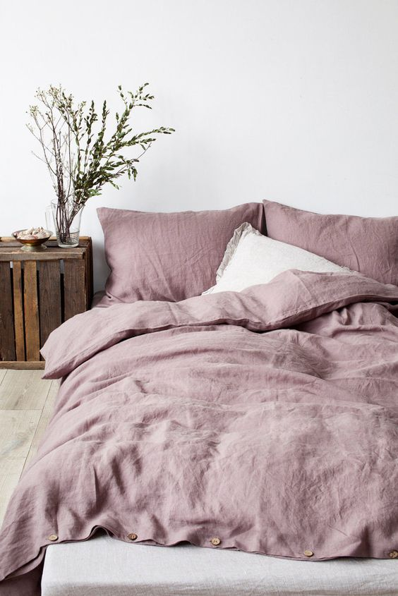 cozy pastel bedding for a rustic bedroom