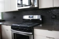 11 glossy black penny tiles for a minimalist black and white kitchen