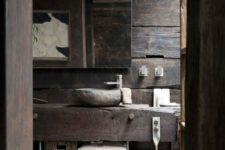 11 rustic bathroom with rough wood and stone decor