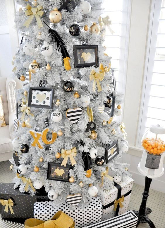 white tree with whimsy white black and gold decor