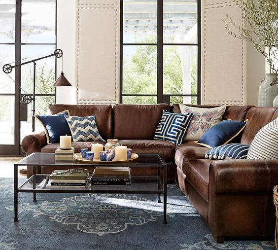 living room with brown sofa. L shaped brown leather sofa looks great and refreshed with navy blue  pillows 26 Cool Brown And Blue Living Room Designs DigsDigs